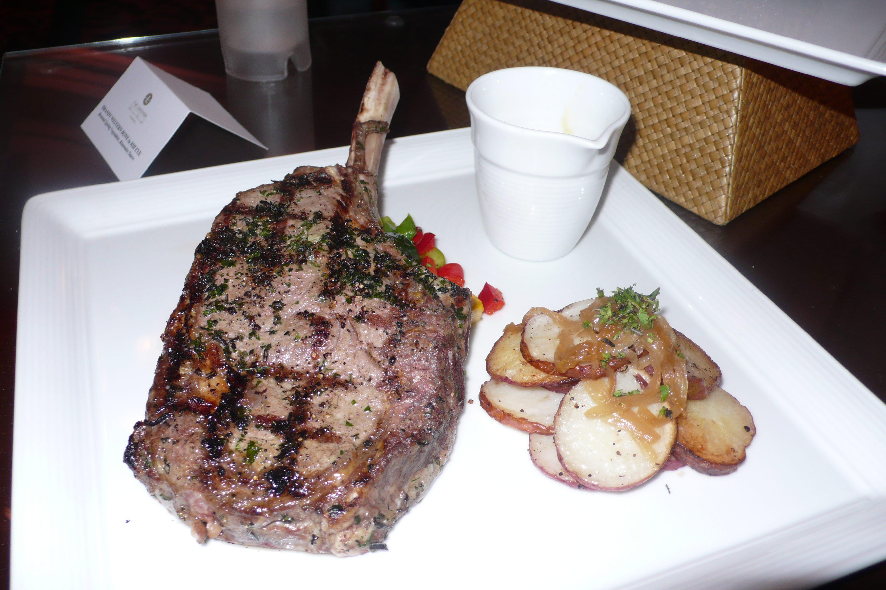 Western bone-in rib eye with roasted veggies and bearnaise sauce