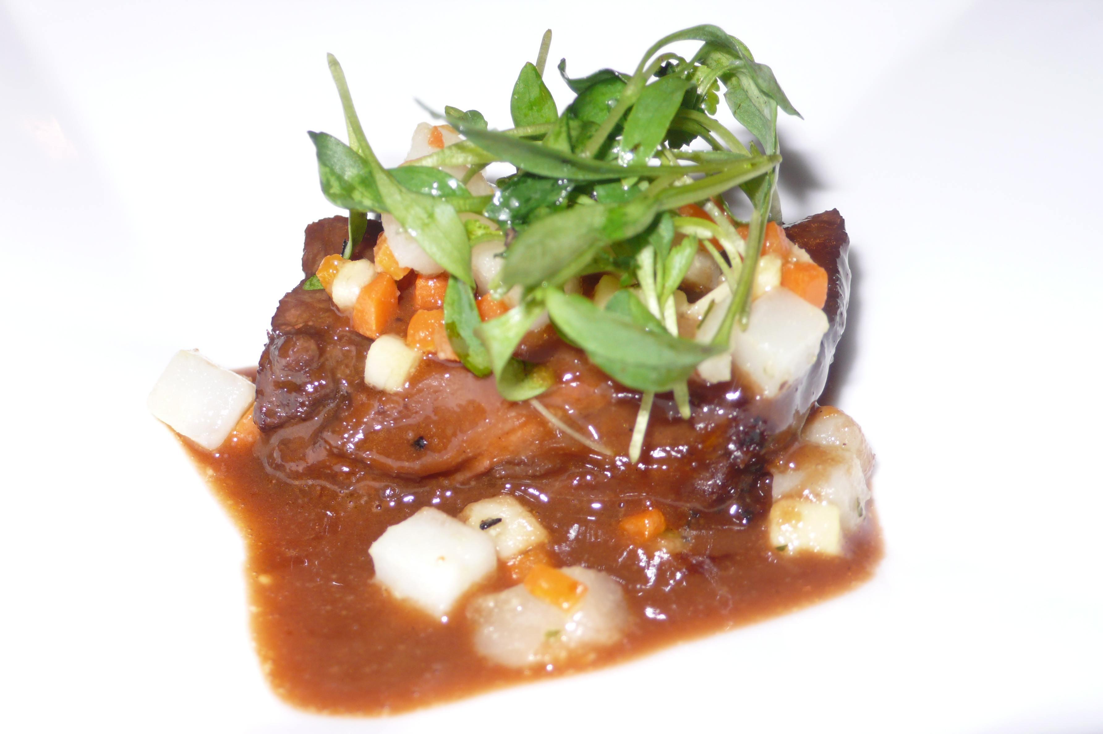 Slow braised short rib with pastroville artochoke and micro cilantro salad