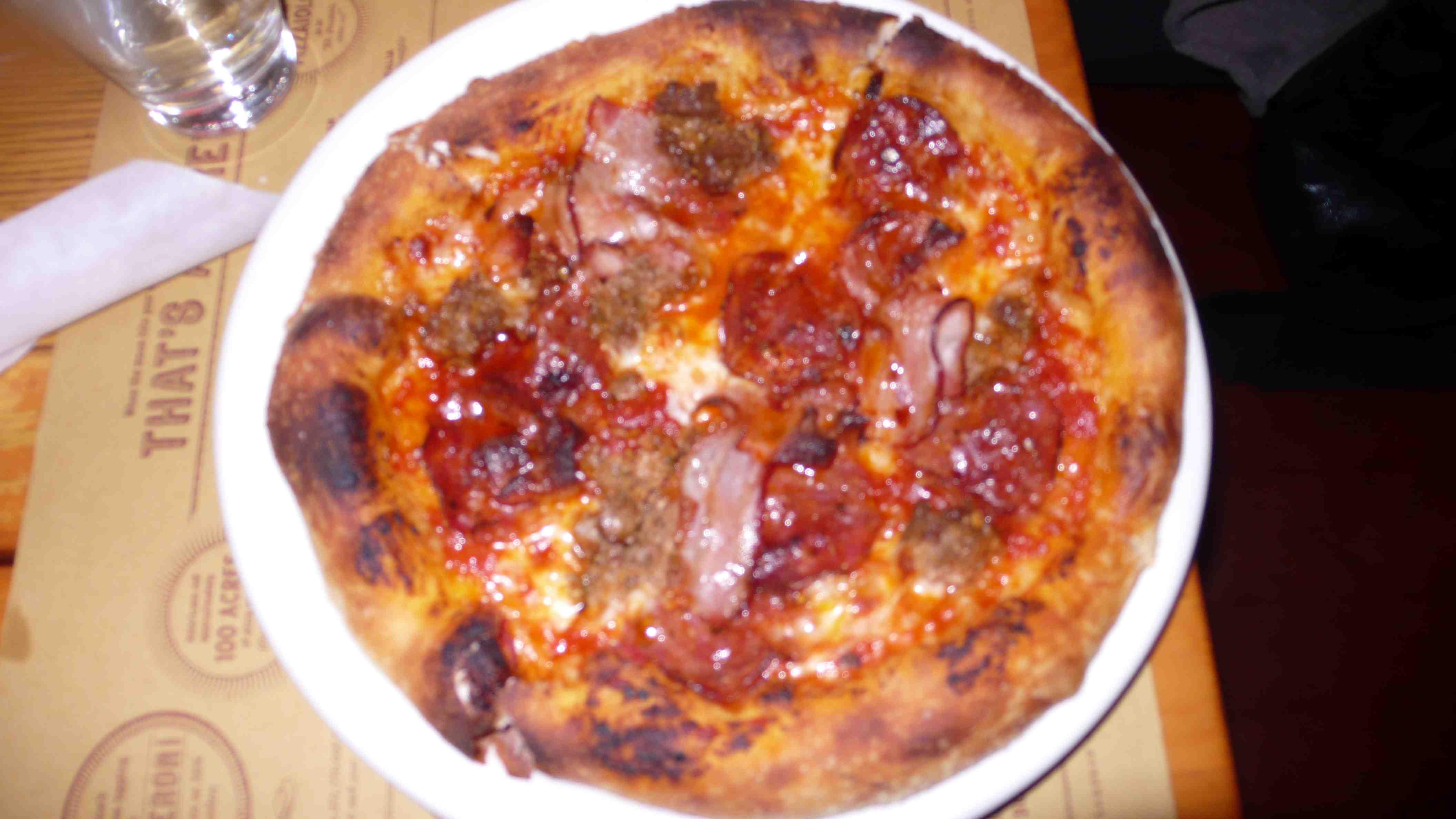 Bacon, salami, sausage, guanciale pizza
