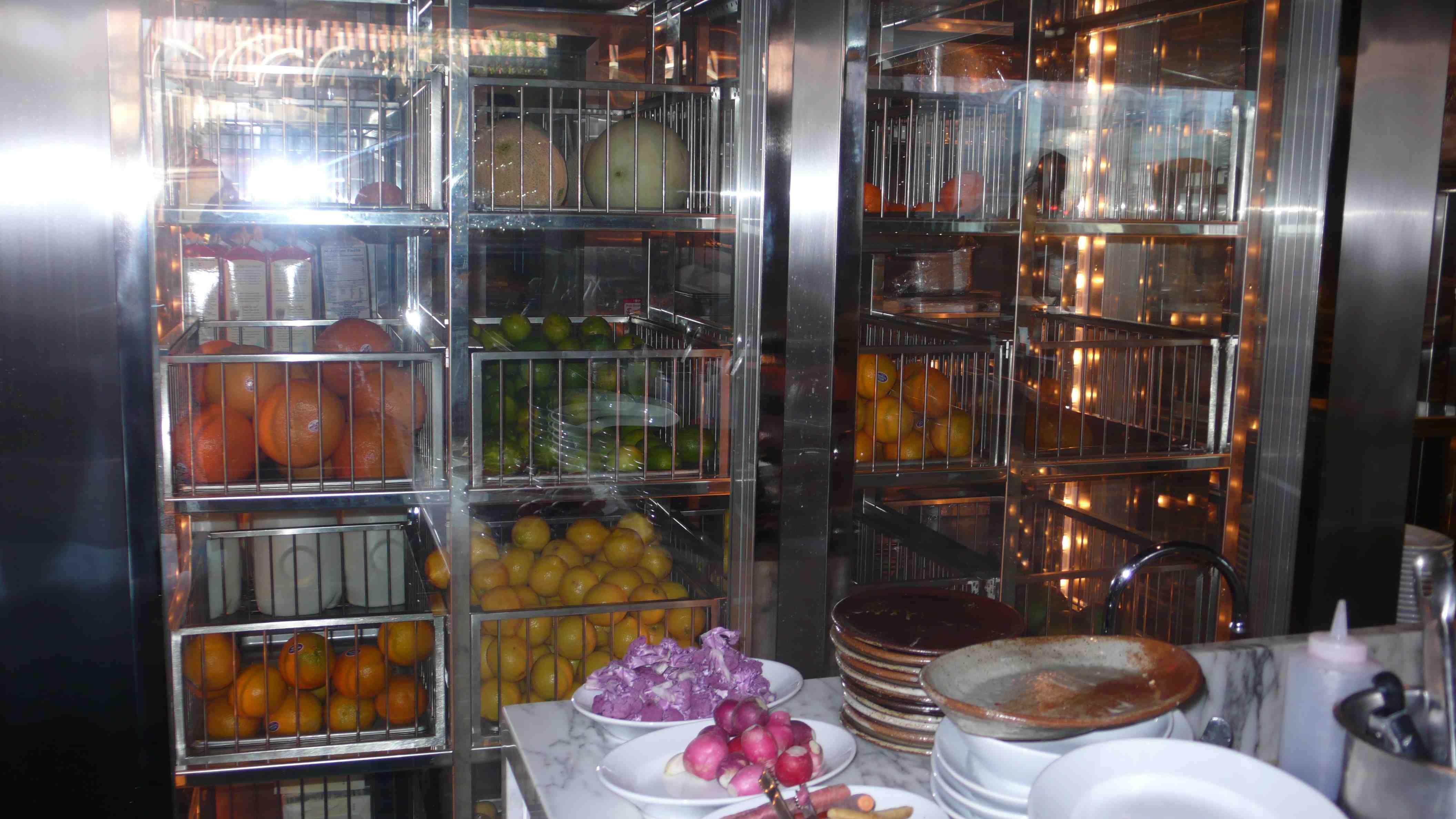 Veggies in open fridge