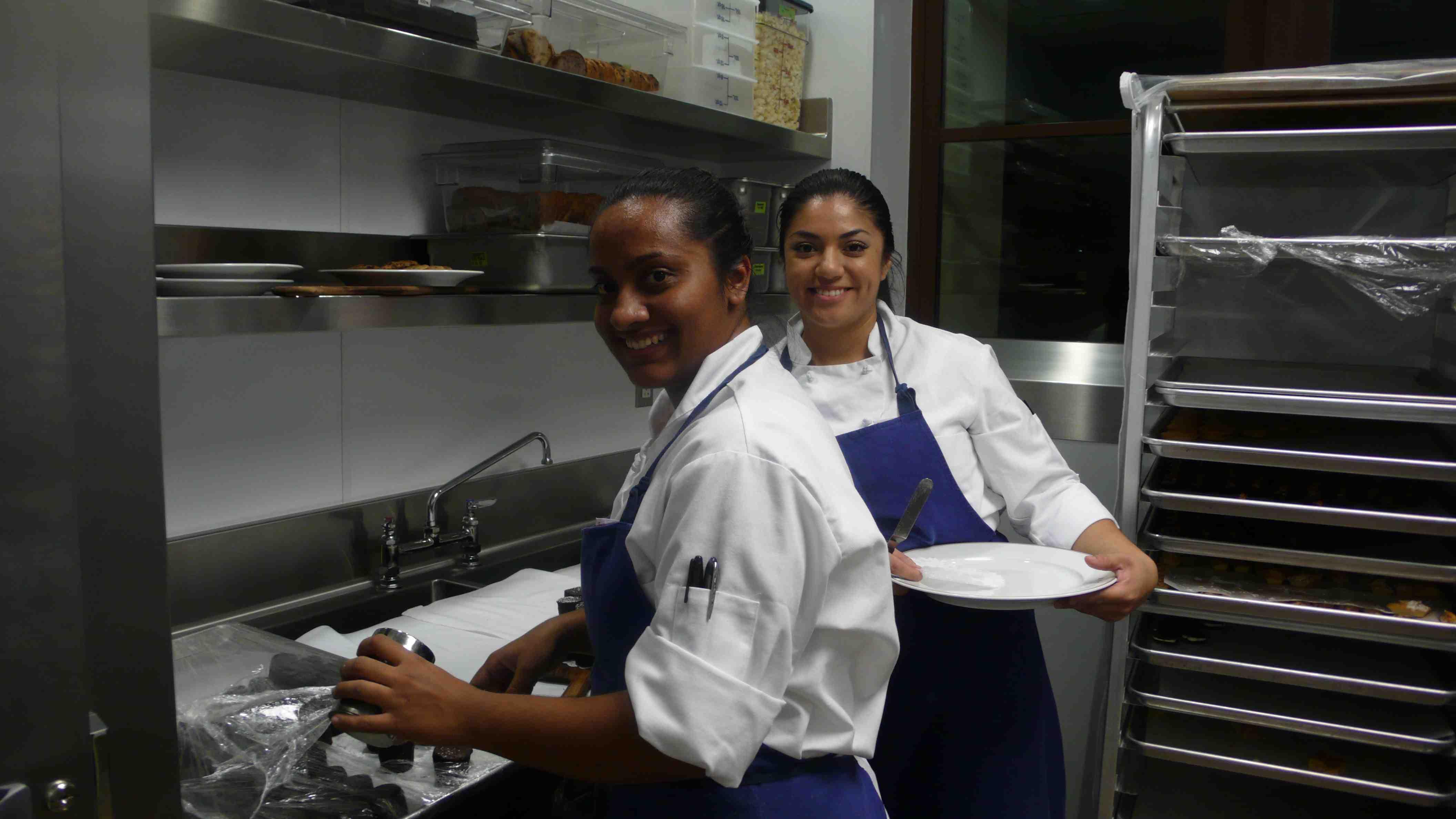 Chefs plating desserts