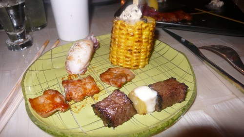 my plate of skewers and corn