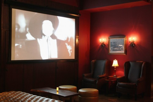 Movie screen at Next Door Lounge