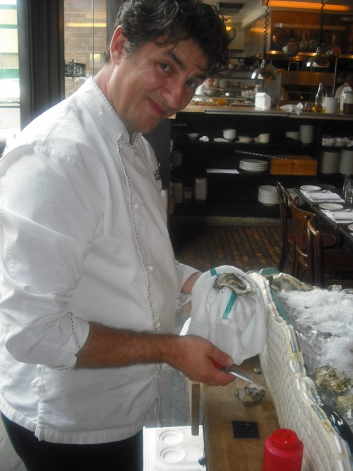 Chef Christophe Happillon shucking oysters