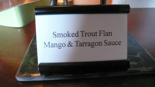 smoked trout flan sign