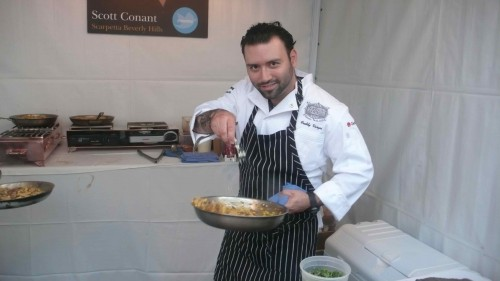 plating food at Scarpetta booth